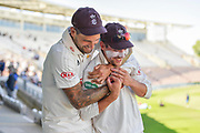 Jade Dernbach of Surrey hugs Rory Burns of Surrey on the way back to the dressing room after the innings and 58 run win over Hampshire during the Specsavers County Champ Div 1 match between Hampshire County Cricket Club and Surrey County Cricket Club at the Ageas Bowl, Southampton, United Kingdom on 11 June 2018. Picture by Graham Hunt.