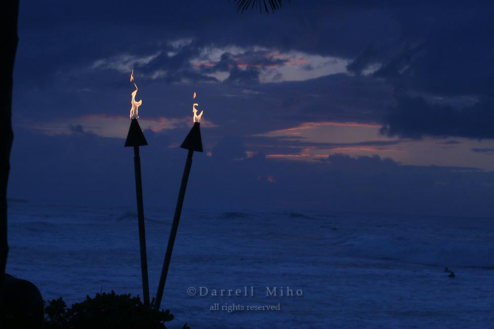 Feb. 17, 2006; Kahuku, Oahu, HI - Tiki torches burn at the Turtle Bay Resort on the north shore of Oahu...Photo Credit: Darrell Miho.© Darrell Miho