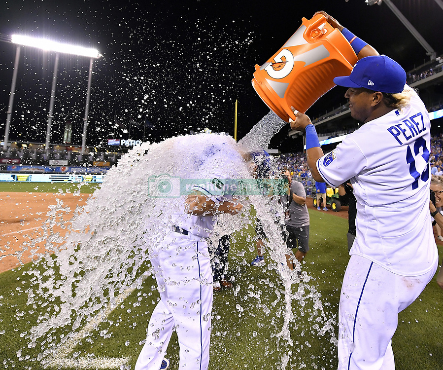 August 3, 2017 - Kansas City, MO, USA - The Kansas City Royals' Salvador Perez inundates Brandon Moss with ice water after the team's 6-4 win against the Seattle Mariners at Kauffman Stadium in Kansas City, Mo., on Thursday, Aug. 3, 2017. (Credit Image: © John Sleezer/TNS via ZUMA Wire)