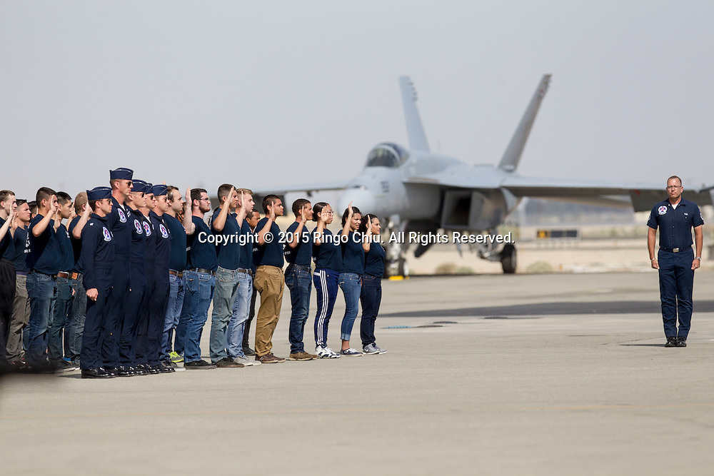 U.S. Air Force cadets salute in the Los Angeles County Air Show in Lancaster, California on March 21, 2015. (Photo by Ringo Chiu/PHOTOFORMULA.com)