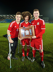 BALLYMENA, NORTHERN IRELAND - Thursday, November 20, 2014: Wales' Liam Angel, Ethan Ampadu and Daniel Jefferies with the trophy after the 2-0 victory over Northern Ireland during the Under-16's Victory Shield International match at the Ballymena Showgrounds. (Pic by David Rawcliffe/Propaganda)