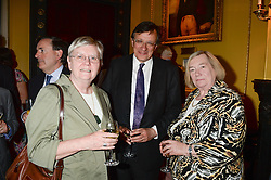Left to right, FRANCES LANNON Principal of Lady Margaret Hall, Oxford, SIR DAVID WARREN and GILLIAN PEELE at a party to celebrate the publication of Strictly Ann by Ann Widdecombe held at the Carlton Club, 69 St.James's Street, London on 6th June 2013.
