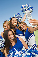 Cheerleaders Posing for Camera Phone