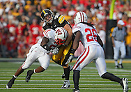 October 23 2010: Iowa Hawkeyes tight end Brad Herman (39) is hit by Wisconsin Badgers cornerback Jay Valai (2) as Wisconsin Badgers cornerback Antonio Fenelus (26) watches during the first half of the NCAA football game between the Wisconsin Badgers and the Iowa Hawkeyes at Kinnick Stadium in Iowa City, Iowa on Saturday October 23, 2010. Wisconsin defeated Iowa 31-30.
