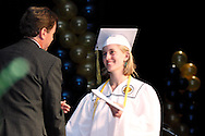 Katherine Byrne Anderson receives her diploma from Board of Education president R. Samuel Davis during the Oakwood High School 88th annual commencement at the Dayton Convention Center in downtown Dayton, Monday, June 4, 2012.