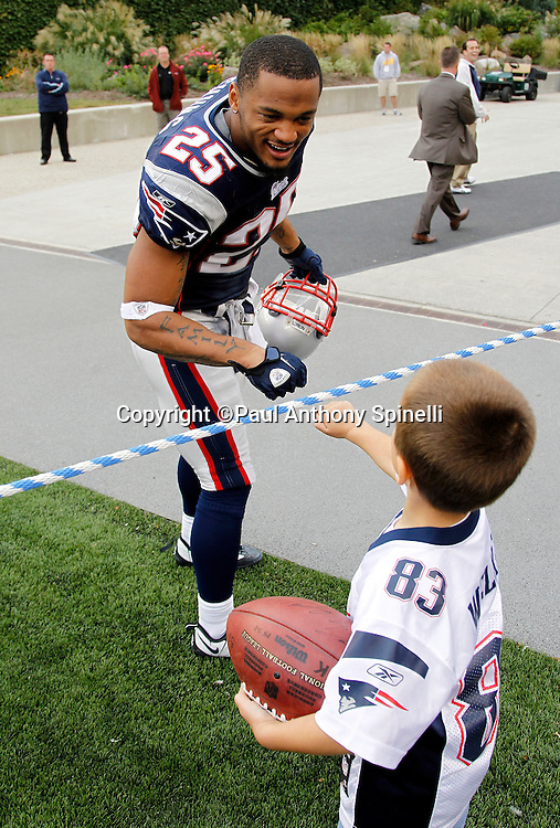 New England Patriots safety Patrick Chung (25) gives a young fan a fist bump during the NFL regular season week 3 football game against the Buffalo Bills on September 26, 2010 in Foxborough, Massachusetts. The Patriots won the game 38-30. (©Paul Anthony Spinelli)