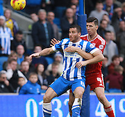 Brighton striker Tomer Hemed shields the ball from Middlesbrough FC defender Daniel Ayala during the Sky Bet Championship match between Brighton and Hove Albion and Middlesbrough at the American Express Community Stadium, Brighton and Hove, England on 19 December 2015. Photo by Bennett Dean.