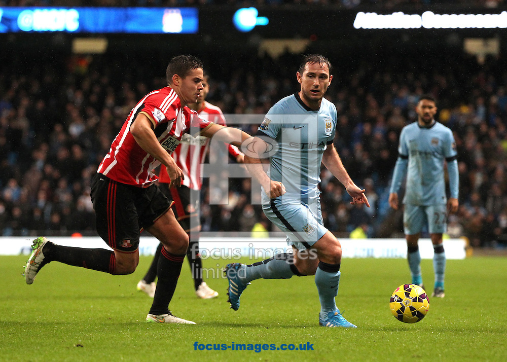 Frank Lampard of Manchester City and Jack Rodwell of Sunderland in action during the Barclays Premier League match at the Etihad Stadium, Manchester.<br /> Picture by Michael Sedgwick/Focus Images Ltd +44 7900 363072<br /> 01/01/2015