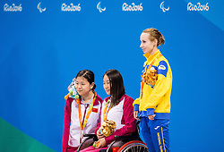Second placed Dong Lu of China, Winner Lingling Song of China and third placed Oksana Khrul of Ukraine celebrate at medal ceremony after the Women's 100m Backstroke S6 Final on day 1 during the Rio 2016 Summer Paralympics Games on September 8, 2016 in Olympic Aquatics Stadium, Rio de Janeiro, Brazil. Photo by Vid Ponikvar / Sportida