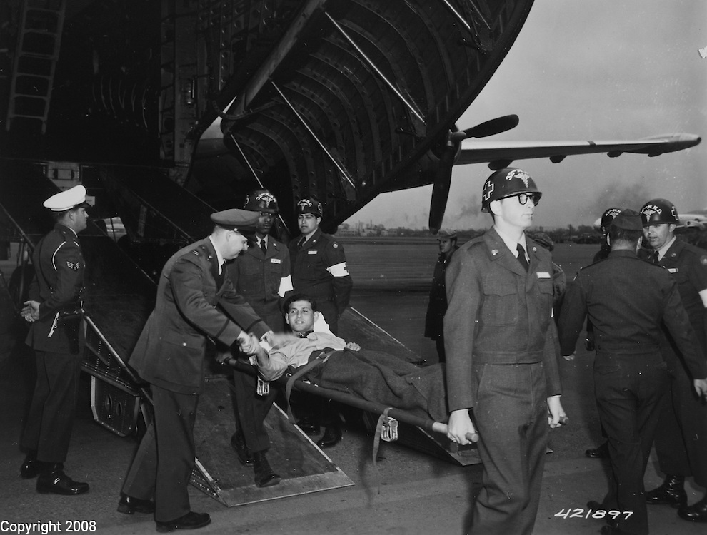 """Operation """"Little Switch"""" -- Pfc. Tibor Rubin of Long Beach, California., 8th Cavalry Regiment, 1st U.S. Cavalry Division, captured by the Communists in Korea and repatriated under terms of the POW exchange, arrives at Tachikawa Air Force Base, near Tokyo, with the second group of repatriates. 22 April 1953."""