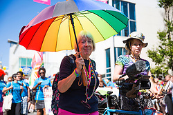 © Licensed to London News Pictures. 06/08/2016. Brighton, UK. Members of the LGBT community take part in the Brighton Pride 2016 parade. Over 160.000 visitors will come to Brighton for the annual Pride event. Photo credit: Hugo Michiels/LNP