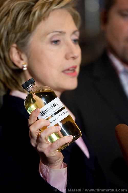 "SEATTLE, WA - Friday, January 27, 2006 U.S. Senator Hillary Clinton (D-NY) holds a bottle of pure B100 biodiesel while Seattle Biodiesel president and founder John Plaza looks on. Clinton joined U.S. Senator Maria Cantwell (D-WA) at Seattle Biodiesel to promote energy independence and call for a greater federal support for ground-brakening alternative energy initiatives already underway at the local level. Cantwell is signing on to Clinton's legislation to create a latter-day ""Manhattan Project"" aimed at accelerating the development of advanced energy technologies.  The two senators, with democratic leader Harry Reid (D-NV) are sponsoring the Advanced Research Projects Energy (ARPA-E) Act to fund alternative energy research. Cantwell states that reliance on foreign oil is a threat to the U.S. economy, competitiveness, and national security and she supports development of non-petroleum based fuels and energy sources. Seattle Biodiesel is working with Cantwell and Washington Governor Gregoire to help develop a market for biodiesel and recently signed a fuel contract with the Port of Seattle. Negotiations are currently underway for Seattle Biodiesel to expand its operations to create the nation's largest biodiesel refinery and to do so on Port property. Clinton is also in the Pacific Northwest to support her fellow democrats at fundraisers and to solidify her support. (Photo by Tim Matsui/WpN)"
