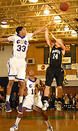 30 DEC. 2011 -- KIRKWOOD, Mo. -- Christian Brothers College High School defender Jordan Barnett (33) leaps to block a jump shot by St. John Vianney High School's Tony Cochran (14) during the championship game of the 34th Meramec Holiday Festival High School Basketball Tournament at St. Louis Community College - Meramec in Kirkwood, Mo. Friday, Dec. 30, 2011. Vianney topped CBC 66-57. Photo © copyright 2011 Sid Hastings.