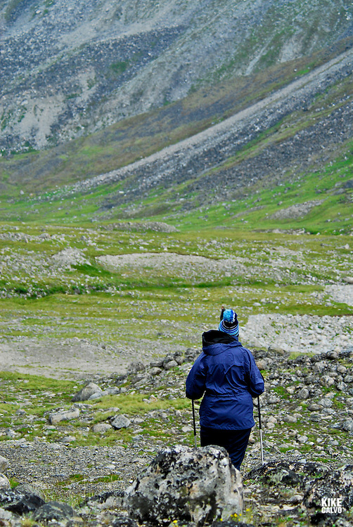 Tourits exploring the Southern part of Baffin Island, Elder woman hicking, Erik Cove, a former site of Hudson Bay Co. post mining company.