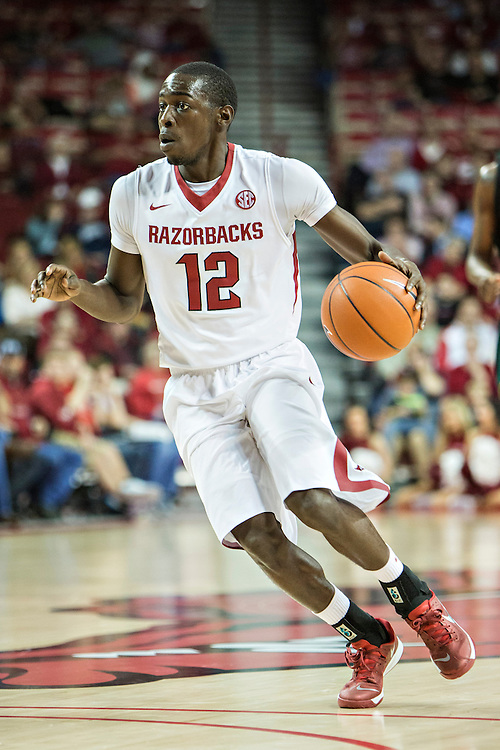 FAYETTEVILLE, AR - DECEMBER 3:  Fred Gulley III #12 of the Arkansas Razorbacks dribbles the ball against the SE Louisiana Lions at Bud Walton Arena on December 3, 2013 in Fayetteville, Arkansas.  (Photo by Wesley Hitt/Getty Images) *** Local Caption *** Fred Gulley III