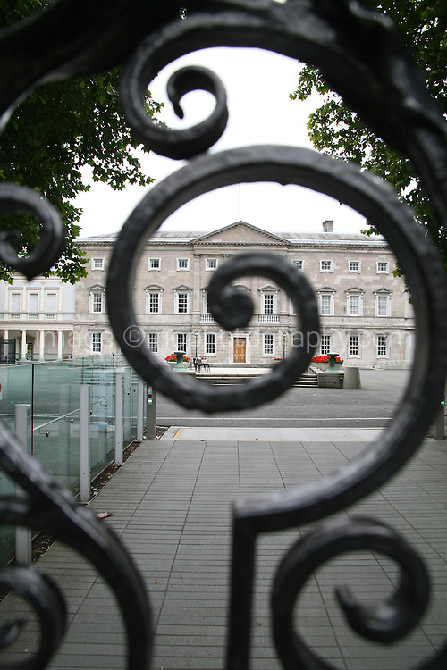 View of Leinster House through gates at Dail Eireann Irish Government buildings on Kildare Street in Dublin
