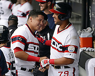 CHICAGO - JUNE 12:  Jose Abreu #79 of the Chicago White Sox celebrates with Avisail Garcia #26 in the dugout after Abreu hit a home run in the sixth inning against the Kansas City Royals on June 12, 2016 at U.S. Cellular Field in Chicago, Illinois.  The Royals defeated the White Sox 3-1.  (Photo by Ron Vesely)    Subject:  Jose Abreu; Avisail Garcia