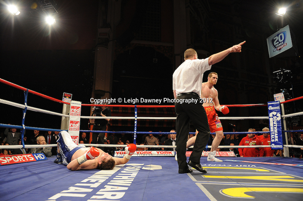 David Price knocks down John McDermott during the 12x3 min contest to claim The British Heavyweight Title Eliminator at Olympia, Liverpool on the 21st January 2012. Referee Howard John Foster. Frank Maloney Promotions on Skysports HD1. © Leigh Dawney Photography 2012.