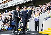 Chesterfield Manager Dean Saunders and Millwall Manager Neil Harris go to take their seats in the dugouts before the Sky Bet League 1 match between Millwall and Chesterfield at The Den, London, England on 29 August 2015. Photo by Bennett Dean.