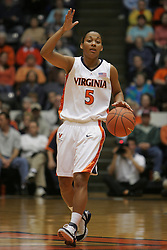 Sharnee Zoll (5) sets the UVA offense against NC State.  The Hoos fell to the Wolfpack 73-63 at University Hall.