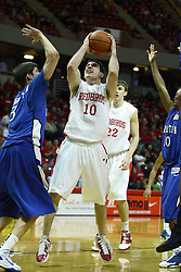 29 December 2010: Alex Rubin offers a shot over Doug McDermott during an NCAA basketball game where the Creighton Bluejays defeated the Illinois State Redbirds at Redbird Arena in Normal Illinois.