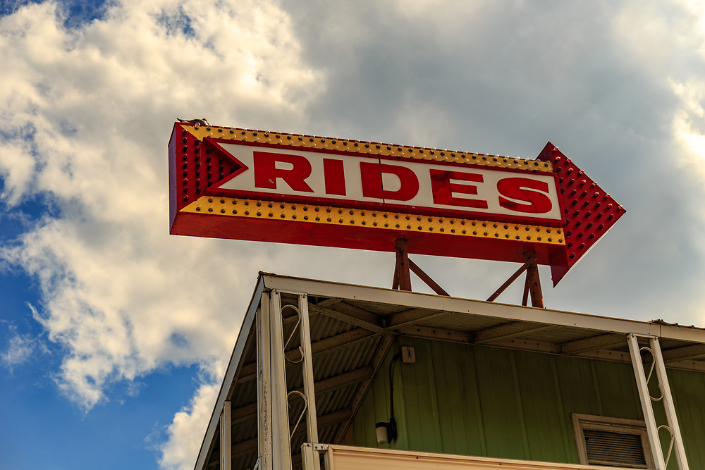 Ocean City, MD - July 10, 2016: A large Rides directional sign pointing toward an amusement pier on the Ocean City boardwalk.