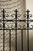 Wrought Iron Gate with patterened shadow in background in New Orleans, Louisiana.
