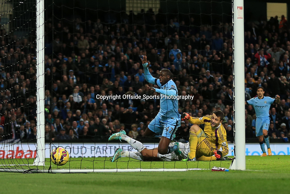 22nd November 2014 - Barclays Premier League - Manchester City v Swansea City - Yaya Toure of Man City scores their 2nd goal - Photo: Simon Stacpoole / Offside.