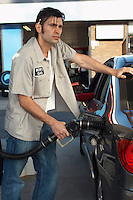 Service attendant pumping gas