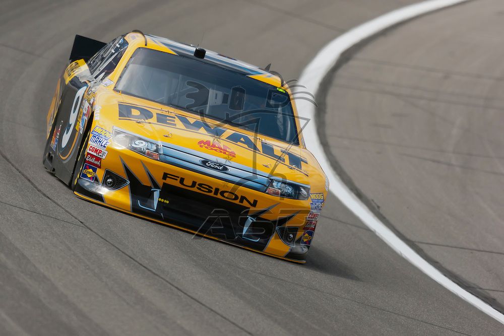 KANSAS CITY, KS - APR 20, 2012:  Marcos Ambrose (9) brings his car through the turns during a practice session for the STP 400 at the Kansas Speedway in Kansas City, KS.