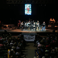 Elvis Tribute Artists line the stage to perform gospel music during Sunday morning's gospel concert, as part of the Elvis Festival, at the BancorpSouth Arena in Tupelo.