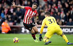 Southampton's Charlie Austin (left) and Manchester City goalkeeper Ederson battle for the ball during the Premier League match at St Mary's Stadium, Southampton.