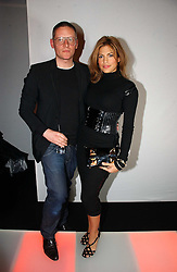 Actress EVA MENDES and designer GILES DEACON at a party to celebrate the launch of a range of leather accessories designed by Giles Deacon for Mulberry held at Harvey Nichols, Knightsbridge, London on 30th October 2007.<br />