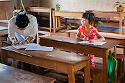 Girl and teacher at school (Vietnam)