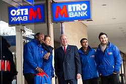 © Licensed to London News Pictures. FILE PICTURE 17/01/2014. London, UK. Founder and chairman of the Metro Bank VERNON HILL (centre) is seen at a newly opened branch in Midsummer Place Shopping centre, Milton Keynes. It has been reported that Metro Bank has used billions of pounds of cheap loans from the Bank of England to invest in the same type of risky deals blamed for the 2008 financial crash. Photo credit: Ben Cawthra/LNP