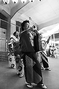 Obon festival, Ukima, Tokyo, Japan, August 21, 2009. Obon is the Buddhist festival of the dead. Celebrations can include dancing and taiko drumming, such as this small event under the train tracks near a small station in Tokyo's Kita Ward.