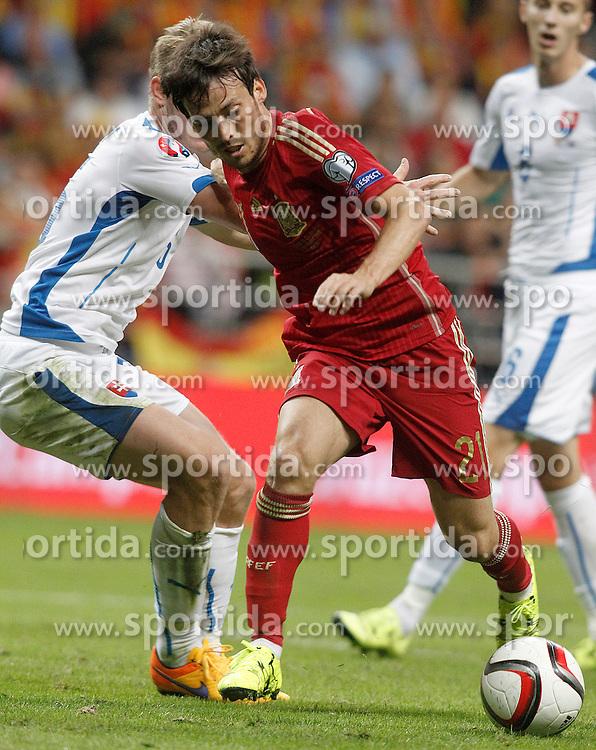 05.09.2015, Stadio Nuevo Carlos Tartiere, Oviedo, ESP, UEFA Euro 2016 Qualifikation, Spanien vs Slowakei, Gruppe C, im Bild Spain's David Silva (r) and Slovakia's Jan Gregus // during the UEFA EURO 2016 qualifier Group C match between Spain and Slovakia at the Stadio Nuevo Carlos Tartiere in Oviedo, Spain on 2015/09/05. EXPA Pictures &copy; 2015, PhotoCredit: EXPA/ Alterphotos/ Acero<br /> <br /> *****ATTENTION - OUT of ESP, SUI*****
