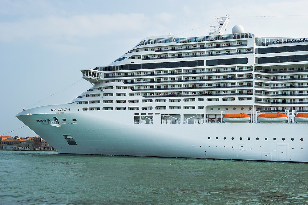 VENICE, ITALY - JUNE 02:  MSC Divina sails along Canale della Giudecca on June 2, 2012 in Venice, Italy. At 139, 000 tons, the MSC Divina can carry nearly 4,000 passengers. FAI (Fonto Ambientale Italiano) is now supporting Venetians and environmentalists in their protetst against cruise ships sailing in St Mark's basin, arguing that the increased boat traffic on Venice's waterways increases pollution and damages property.  (Photo by Marco Secchi/Getty Images)