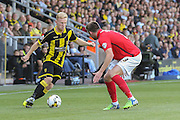 Burton Albion midfielder on loan from Birmingham City Mark Duffy takes on Coventry City defender Chris Stokes during the Sky Bet League 1 match between Burton Albion and Coventry City at the Pirelli Stadium, Burton upon Trent, England on 6 September 2015. Photo by Simon Davies.