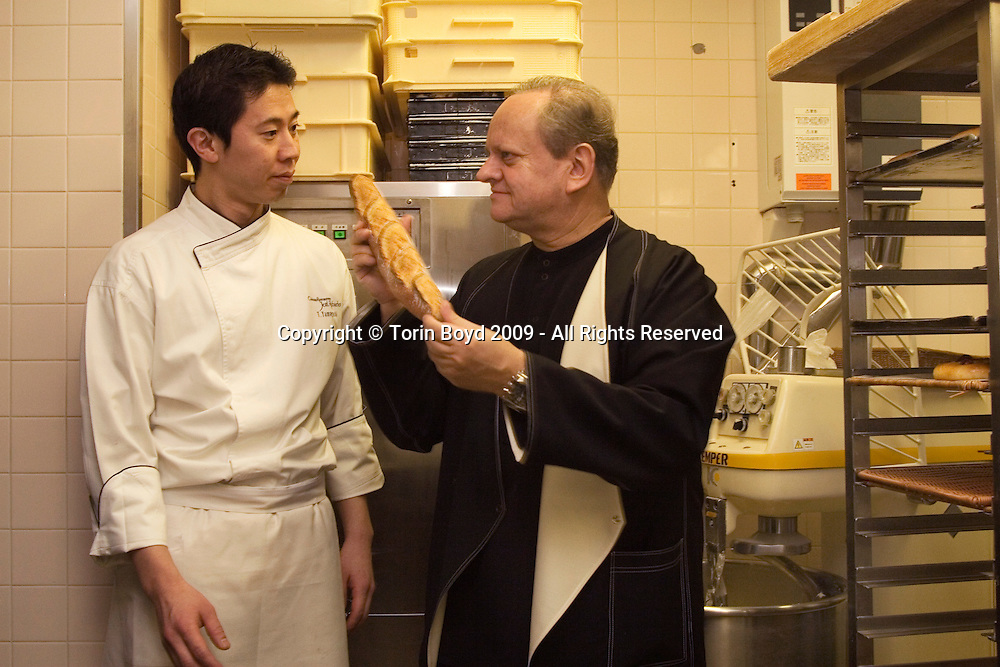 "This is world renowned chef Joel Robuchon in Tokyo, Japan. He is seen here on February 7, 2009 visiting his exclusive restaurant Le Chateau de Joel Robuchon located in Tokyo's Ebisu Garden Place. The Japanese man with him is his ""Chef Boulanger"" Tetsuya Yamaguchi (not wearing a chef hat). Robuchon was in town to attend an international food exposition called ""2009 Tokyo Taste"". This three day event from February 9-11, 2009 showcases some of the world's most famous chefs including Robuchon and Ferran Adria (of El Bulli) who are both Honorary Advisors to this event. Other chefs participating in this event are Heston Blumenthal, Pierre Gagnaire, Jacques Puisais, Bruno Menard, Herve This, Ferran Adria, and Nobuyuki Matsuhisa to name a few. Robuchon has restaurants in Tokyo and Nagoya Japan including; L'Atelier de Joel Robuchon and Le Cafe Joel Robuchon. These establishments are connected with Four Seeds Corporation, a Japanese corporation that owns and operates several popular restaurant chains around Japan."