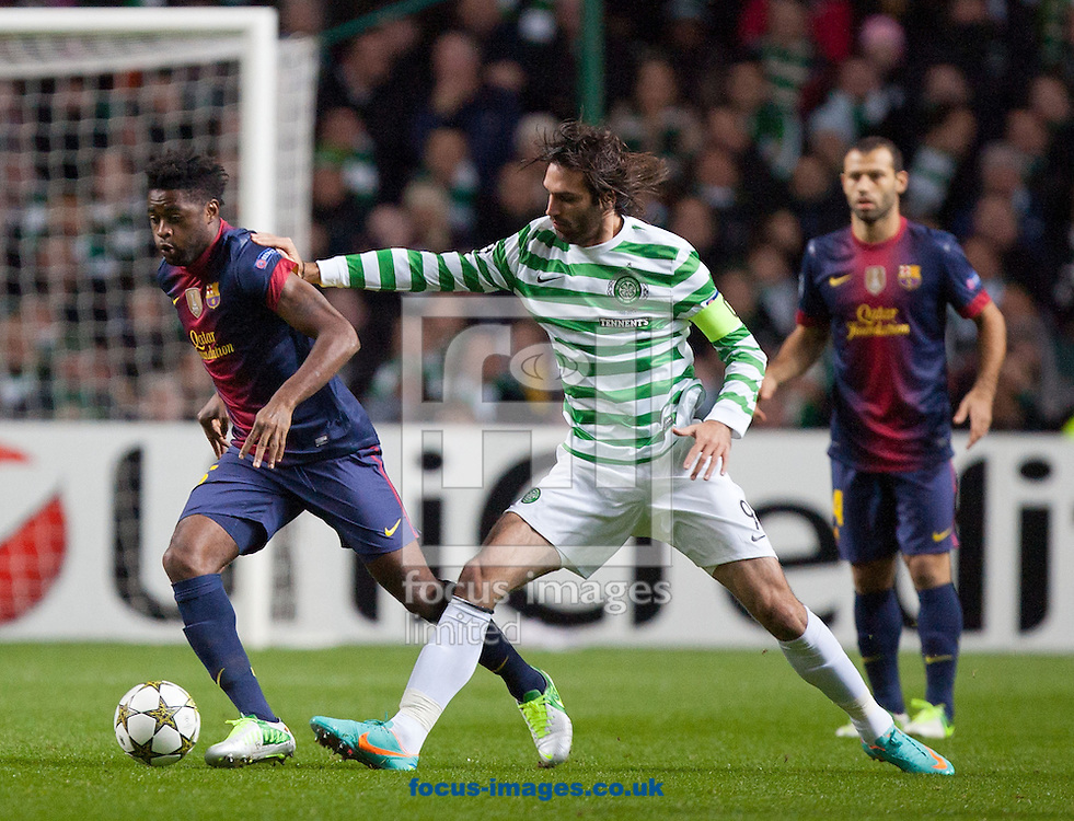 Picture by Chris Clark/Focus Images Ltd +44 7748 112188.07/11/2012.Alex Song of FC Barcelona is tackled by Georgios Samaras of Celtic during the UEFA Champions League match at Celtic Park, Glasgow.