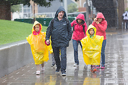 © Licensed to London News Pictures. 26/08/2015. London, UK. Tourists and visitors on the South Bank in London during heavy rain and wet weather today. Photo credit : Vickie Flores/LNP