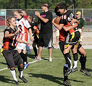 Seniors Amy Green (12, left) and Kelly Blumenschein (16) celebrate their 14-0 victory at the 3rd Annual Powderpuff Challenge, the junior girls (class of 2008) against the senior girls (class of 2007.)