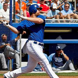 March 16, 2012; Dunedin, FL, USA; Toronto Blue Jays first baseman Adam Lind (26) against the Tampa Bay Rays during a spring training game at Florida Auto Exchange Stadium. Mandatory Credit: Derick E. Hingle-US PRESSWIRE
