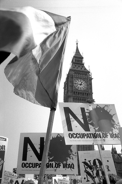 The Big Ben framed by thousands of banners and flags in one of the mass protests to stop the occupation of Iraq. London, 12/04/2003<br /> <br /> This photo was published on the Daily Telegraph on 6th of July 2016 following the release of the Chilcot Report <br /> http://www.telegraph.co.uk/news/2016/07/06/key-findings-from-the-chilcot-report/