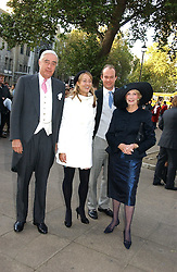 MR & MRS RUPERT HAMBRO, their daughter FLORA HAMBRO and HENRY NEAME at the wedding of Clementine Hambro to Orlando Fraser at St.Margarets Westminster Abbey, London on 3rd November 2006.<br />