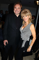 SALLY FARMILOE and RICHARD MAYHEW at a fashion show of the new fashion label Chester Bonham held at the Aston Martin Showroom, Park Lane, London on 15th November 2004.<br />