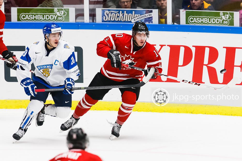 140104 Ishockey, JVM, Semifinal,  Kanada - Finland<br /> Icehockey, Junior World Cup, SF, Canada - Finland.<br /> Teuvo Teravainen, (FIN), Charles Hudon, (CAN).<br /> Endast f&ouml;r redaktionellt bruk.<br /> Editorial use only.<br /> &copy; Daniel Malmberg/Jkpg sports photo