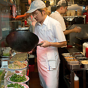 Chef Danny Bowien works in the kitchen of his restaurant, Mission Chinese, at its New York City location on the Lower East Side of Manhattan on Tuesday, July 31, 2012 in New York, NY..