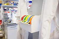 Rolls of multi-coloured labelling tape in laboratory